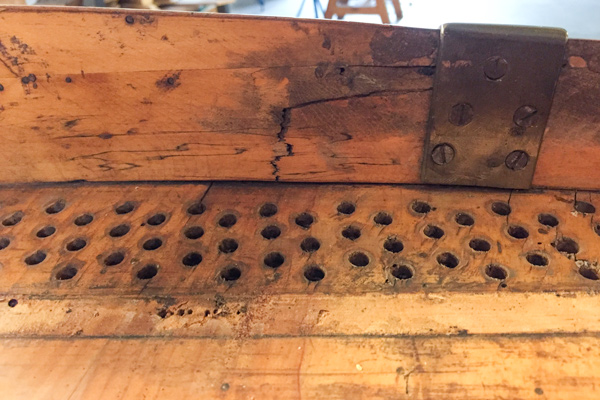 5. From behind: crack at the back of the painting, also showing the big holes for modern tuning pins.
