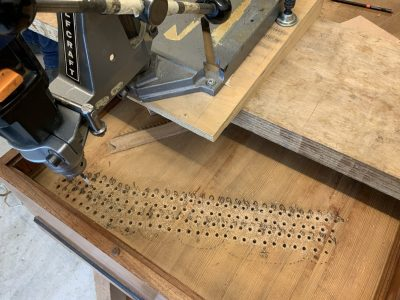Drilling pinholes in the new top layer